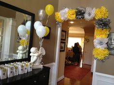 Grey, White, and Yellow Bridal Shower Decorations. Make tissue paper Pom-poms using 5 sheets of tissue paper for each. Using more will make Pom poms too fluffy. You need to be able to make one side flat. I made smaller ones to add some variety, and used painter's tape to hang up.