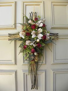 Wrought Iron Door Cross Arrangement - lovely at Easter! Easter Wreaths, Holiday Wreaths, Christmas Decorations, Church Flowers, Funeral Flowers, Wreath Crafts, Diy Wreath, Door Wreaths, Cross Wreath