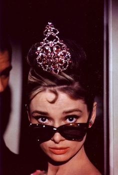 Breakfast at Tiffany's: Holly Golightly's most brilliant headpiece is a twinkling pink tiara. Costume designer, Givenchy. Was the tiara Edith Head's doing?