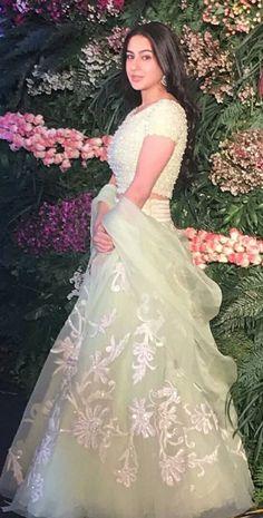 Sara Ali Khan in a pistachio green Aisha skirt and blouse embellished with resham, bugle beads and crystals by Abu Jani Sandeep Khosla Couture for Virat Anushka's reception #saraalikhan #abujanisandeepkhosla #virushkaweddingreception
