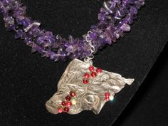 Silver clay pendant with Dichroic glass dots on a necklace of amethyst chips
