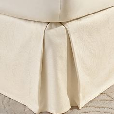 Brimming with classic style, this lovely bed skirt brings tailored lines to your guest room or master suite.  Product: Bed skirt...