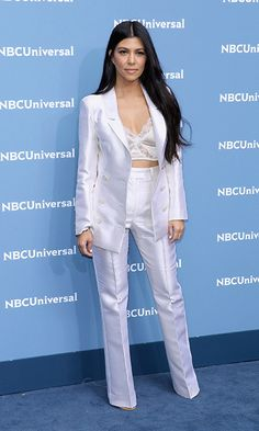 Kourtney Kardashian's suit met sexy with a white bralette under her jacket at an event in New York.