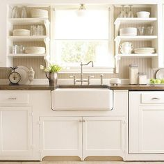 Lovely cottage kitchen design with beadboard backsplash, white apron sink, white open shelves, white kitchen cabinets with marble counter top, French windows and polished nickel faucet. Kitchen On A Budget, Kitchen Redo, New Kitchen, Kitchen Cabinets, Kitchen Ideas, Kitchen Shelves, Kitchen White, Kitchen Sinks, Kitchen Inspiration