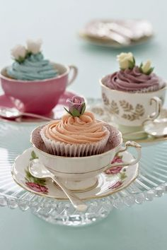 .teacups as favors? could get nice ones at the thrift store and put cupcakes in them!
