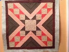 Machine quilting tutorial on how to quilt those orange triangles.  Pat Sloan's Globetrotting BOM Washington DC video 6