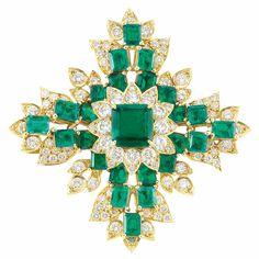 Gold, Emerald and Diamond Maltese Cross Clip-Brooch  18 kt., one square-shaped emerald-cut emerald ap. 4.31 cts., 24 rectangular-cut emeralds ap. 11.00 cts., 112 round diamonds ap. 5.45 cts., ap. 24 dwts