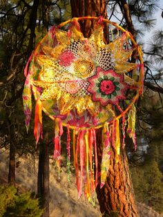 a dream catcher, using colorful vintage doilies