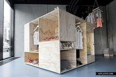 Inspired by the large wooden crates used in the shipping industry, the design for Zalando's Pop-Up Store features three free-standing boxes, each revealing a separate collection.