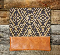 Ships out 2 to 4 days after purchase. This foldover clutch has an eye-catching blue and tan ikat fabric design with a copper brown faux leather Fabric Bags, Ikat Fabric, Diy Wallet, Burlap Bags, Diy Bags Purses, Diy Accessoires, Fabric Stamping, Foldover Clutch, Boho Bags