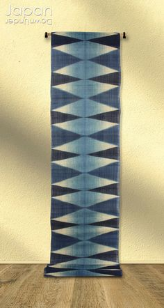 A beautiful handmade aizome wall hanging. It was made in Tokushima, the center of traditional indigo dye production in Japan. The long wall hanging is hand stenciled in a geometric design, with various shades of indigo, on a beige linen background. The see through effect of the linen gives the wall hanging an airy, cool feeling especially during the hot summer! #aizomelinen #wallhanging #indigotapestry #indigowallhanging #handdyedwallhanging by #JapanDownUnder on Etsy Indigo Plant, Indigo Dye, Indigo Walls, Japanese Wall Art, Colored Bubbles, Tokushima, Long Walls, Asian Decor, Tapestry