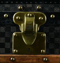 5208ce717f2 In Georges Vuitton, Louis Vuitton s son, was a very prominent lock maker.  He mastered the craft   essentially originated the