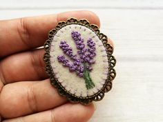 Embroidered Lavender Brooch, Floral Brooch, Lavender Flower Brooch, Lilac Brooch, Its a perfect Gift for mom or any other women that loves flowers and most of all lavender This listing is for 1 embroidered brooch Vintage style handmade embroidered jewelry. Basic fabric is wool felt. It is free style hand embroidery. Every peace I create is very different because I dont use any patterns for this embroidery. Finding is bronze brass brooch Embroidered area is 30x40 mm (1 3/16 x 1 9/1...
