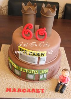 Coronation Street Themed two tier cake with The Rovers Return & The Kabin themed tiers & the iconic chimney pots