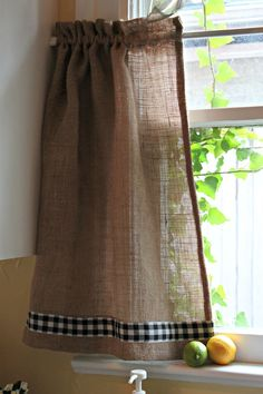 Burlap and gingham curtains.