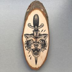Wood slice with an original drawing of a tiger and door Inkspirednl