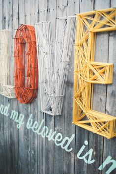 Custom Wedding Wall by Chase and Aaron Kettl! Hand made, yarn strung, hand painted typography on reclaimed wood. DIY!  Custom Wedding Wall by Chase Kettl, via Behance