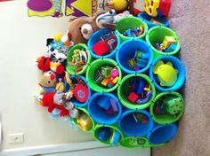 Sara this is genius Use 18 plastic buckets to organize kids toys. I'm going to create a different shape, but this looks like a simple DIY project...