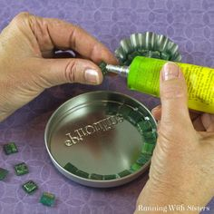 She carefully glues glass tile to a mason jar lid. What it becomes? This is SO cool!