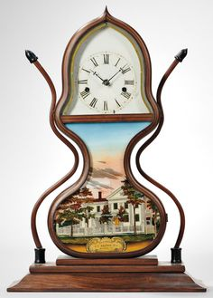 Acorn clocks are extremely fragile, so few survive in original condition. This circa 1845 example includes a colorful reverse-paint glass tablet showing the residence of maker J. C. Brown. It sold for $5535. Skinner photo. Skinner, Inc., Marlborough, Massachusetts, April 29, 2016.