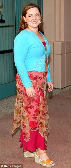Now and then: Melissa McCarthy, seen here left promoting her new movie The Heat on Monday, says she is happy with her fuller size. On the right she is seen in April 2003
