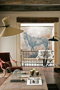 Horse art in unexpected technique can speak. I love this framed by the doorway. It invites one to seek it out for a closer look,