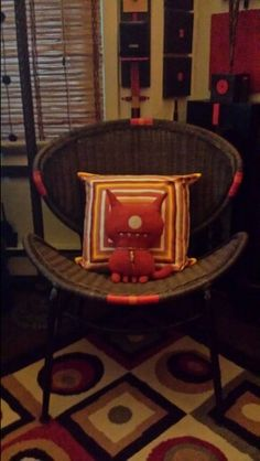 Broader view...brown wicker chair...Red Ugly doll's favorite spot