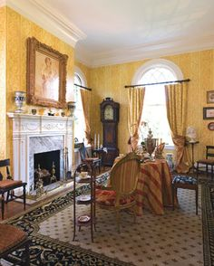 "Front Parlor In this elegant space, designer David Ballas reflects the lifestyle of Tara II's well-traveled owners with objects collected abroad, while also emphasizing the Old World charm of the house. The swagged polyester-blend draperies by Greenhouse Design exemplify Ballas's philosophy that ""you can be traditional and eclectic by using two different fabrics—one on the face and one for the lining."" The panels can be tied back or pulled entirely closed on the rings and rod. Decor, Indoor Decor, Old House, Interior, Old World Charm, House, Indoor, Home Decor, House Interior"