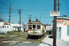 """""""San Diego Electric Railway streetcar on the South Park diagonal between 30th St. and Fern St. (at Ivy St.) in the late 1940s."""" Currently, the Station is located here. Note the golden flowers...Golden Hill."""