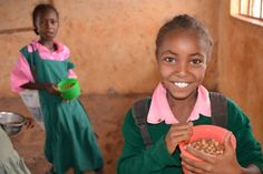 Daily nutritious school meals, like the ones provided to these girls in Kenya, help boost education and access to education. (16 October 2014, Photo: Amanda Lawrence-Brown) #DoTheMath #SolveHunger