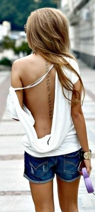 Would want something like this down the middle of my back but in Spanish or Gaelic