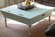 Good as new - Coffee table upcycled from neighbor's trash pile by adding legs and refinishing.