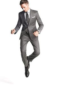 Grey Suit, white shirt, white pocket square, black/white striped tie. Black shoes. Accessories black watch.