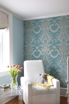 Bold, blue damask wallpaper in a shabby chic nursery!