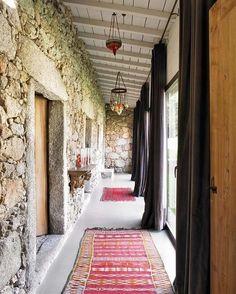 best foyer ever! stone walls, key stones, moroccan lighting, kilim rugs...love!