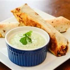 An assortment of traditional Southwestern-style ingredients are wrapped inside small flour tortillas and deep fried.