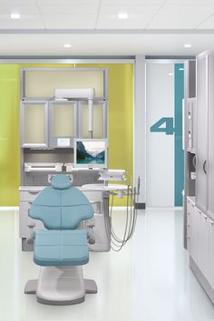 A-dec 500 dental chair in Cyan with Inspire dental cabinets and colorful design.