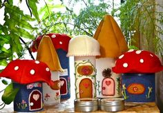 food canisters into mushroom houses... I'd use woodgrain contact paper on the canisters & make the caps from paper clay