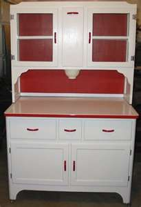 TS-204 this is a nice red and white hoosier cabinet. It measures.