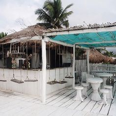 Don't miss the beach bar Coco Tulum with it's swing chairs. It is best to go at sunset!