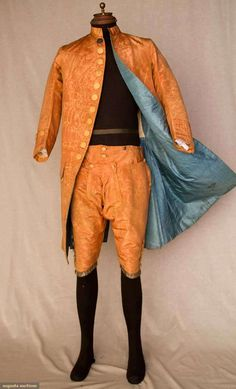 Gentleman's peach silk moiré faille suit with embroidered and spangled buttons and silver trim,1760s.