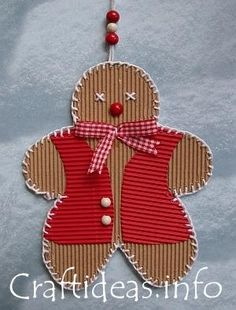 Gingerbread ornament from corrugated cardboard with blanket stitched edges and cross-stitch eyes.  Sweet !