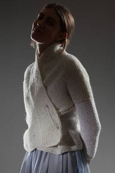 Daniela Gregis | cardigan in garter stitched linen | cardigan in garter stitched linen, shawled neck, two pocket at the hem, big pin safe closure, one sleeve in a lighter white colour | article code: 23712 | season: Spring/Summer | composition: 100% linen