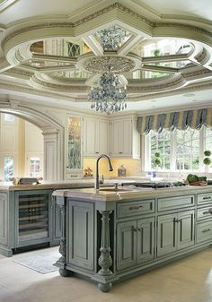 This neutral colored kitchen has the decor of a palace.