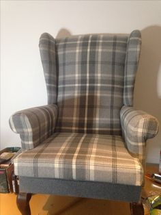 Recovered in a soft grey upholstery fabric, fit for a new home