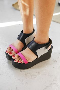Sandal Stalking! Check Out 28 Cool Pairs Spotted On Real L.A. Girls #refinery29  http://www.refinery29.com/35818#slide27  Urban Outfitters nails it with that bold, neon strap!