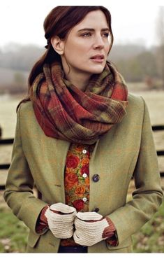 Orange and red floral blouse, green tweed jacket, plaid scarf, gloves. Winter style in autumn colours.