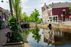 Photo of canal in Delft. See the cutest canals in Delft with this FREE self-guided walking tour of Delft with a perfect one day itinerary for Delft! #Delft #Travel