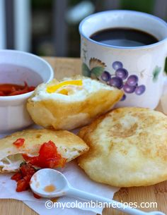 Arepa de Huevo is a typical dish from the Caribbean region of Colombia where they are sold on street stalls. These arepas are served in Colombian homes for My Colombian Recipes, Colombian Food, Colombian Arepas, Corn Cakes, Spanish Dishes, Comida Latina, Egg And I, Latin Food, Afternoon Snacks