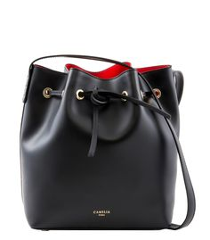 Leather bucket bag with adjustable shoulder straps.
